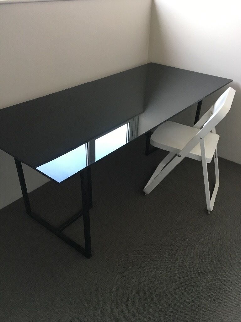 DeskHabitat clear black deskin Bournemouth, DorsetGumtree - Habitat Kusa Desk Beautiful modern black glass desk with 1.2 cm thick tempered black glass top. Includes two black moveable steel trestle legs. Excellent condition but may contain some minor scratches. This item is heavy to move. Size of desk top is...