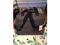 Storksak Jude convertible baby changing bag.