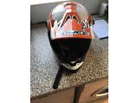 Orange skull motorcross helmet