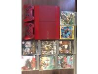 Rare Red PS3 slim 500gb with 2 controllers and 8 games.
