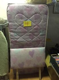 Single bed with mattress and head board