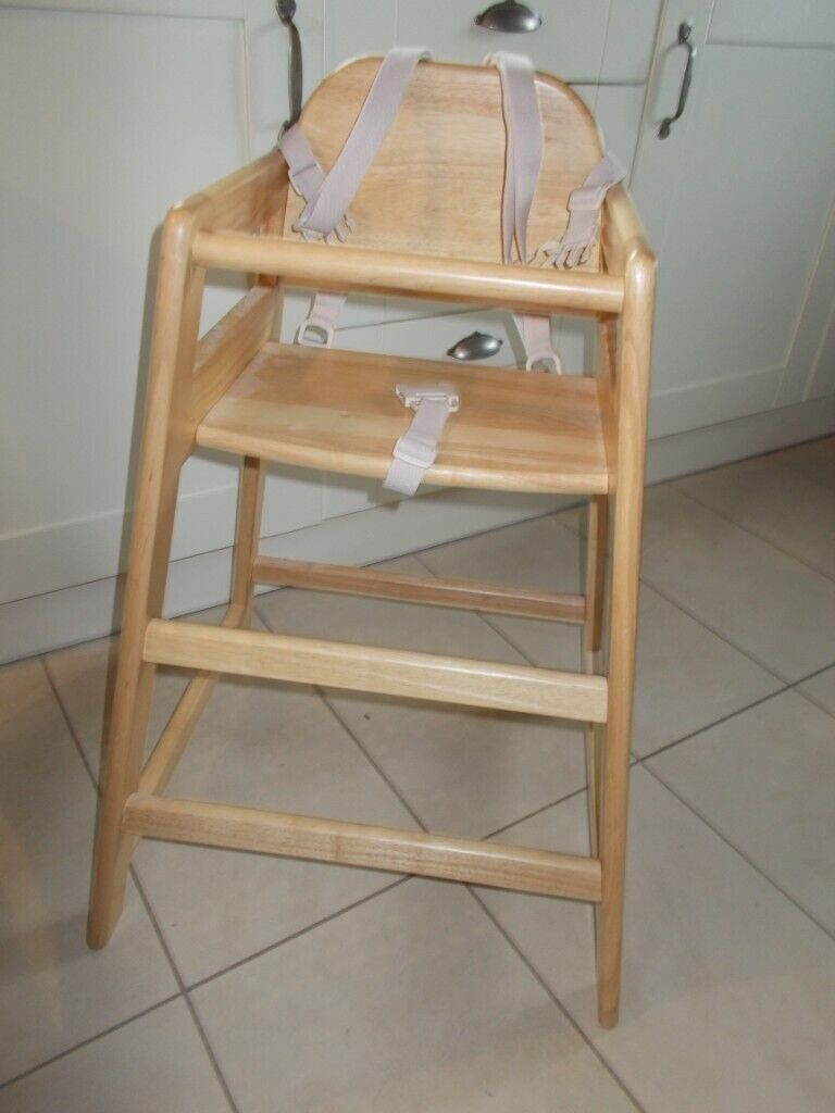 A EAST COAST NURSERY / CAFE WOODEN HIGH CHAIR, INCLUDES FOOTREST AND FULL  SAFETY HARNESS.  in Henley-in-Arden, Warwickshire  Gumtree