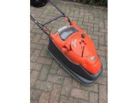 Flymo hover mower with grass viewing window and cord storage