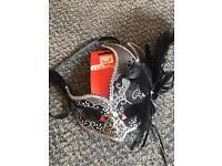 Black and grey masquerade mask
