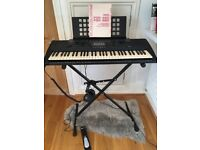 Yamaha PSR-320 keyboard, bundled with stand, Mgear damper/sustain pedal, user manual, headphones.