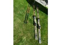 Head skis (170cm), poles and bag.