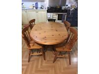 Oval shaped drop leaf pine dining table with 4 chairs