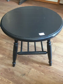 Wooden table , painted in black , with open shelf below Solid table with nice shape 22 in H 18 in