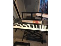 Yamaha electric keyboard excellent condition. Stool and stand