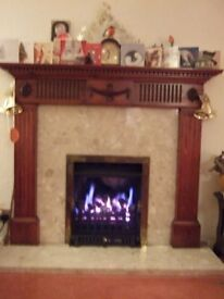 Fire place. Classic dark stained wood. Comes with marble effect insert, hearth & gas fire