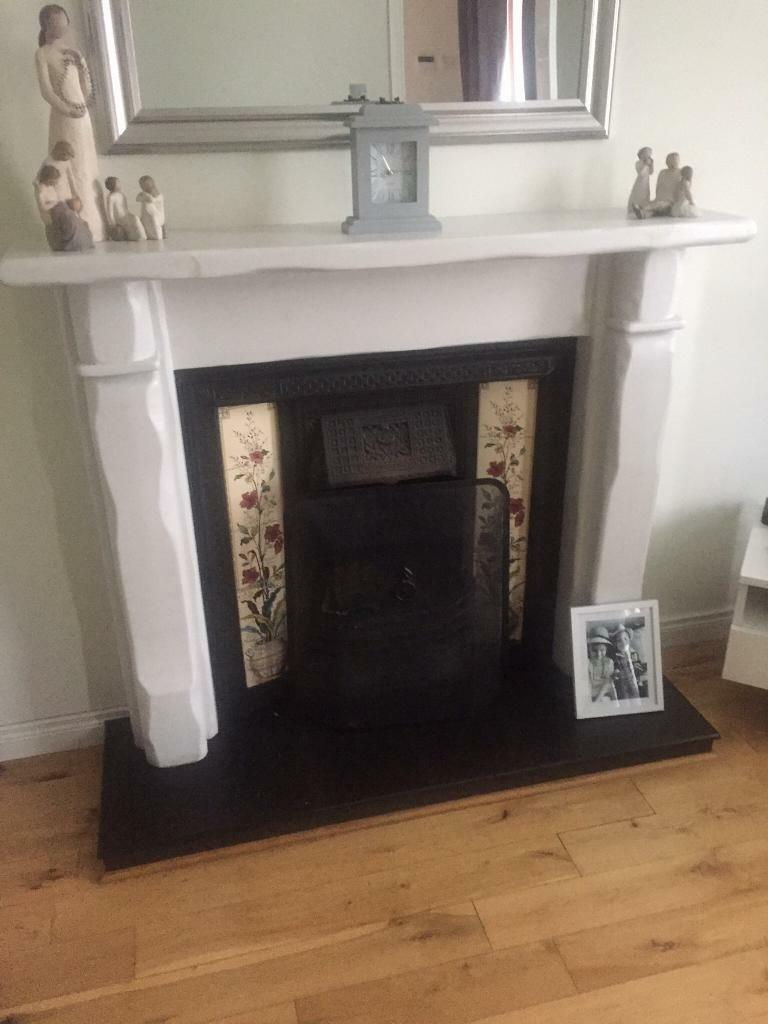 Cast iron fireplace, wooden surround and slate hearth.