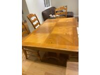 large wood, solid dining table with 6 chairs!