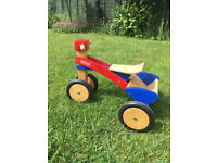 Toddler wooden PINTOY ride on trike with boot for toys