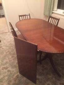 Dining Table in dark wood and 6 matching chairs