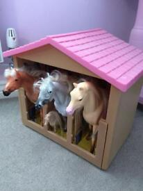 Kids horses shed and horses