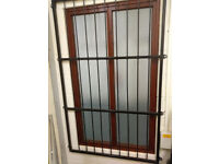 Wrought iron security window bars ideal for an office or shop.