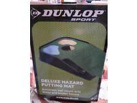 Dunlop golf practice mat.