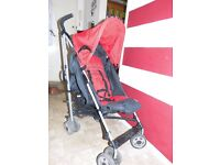 Hauck red buggy used with rain cover and footmuff.