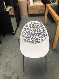 Set of four cut out chairs stackable