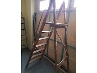 Wooden step ladder with platform and hand rails