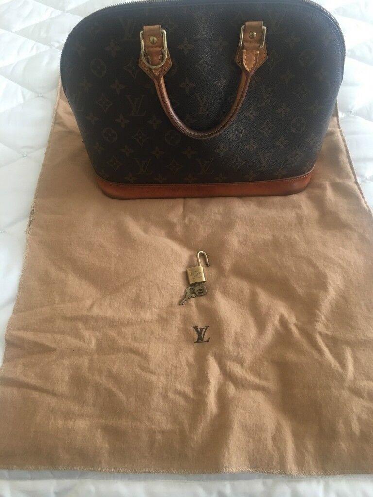 cea594897983 Genuine Louis Vuitton Alma Handbag in Brown Monogram Canvas and Natural  Leather