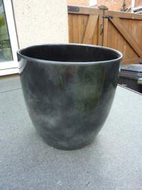 Ceramic indoor plant pot .