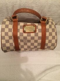 Michael Kors and Louis Vuitton bags