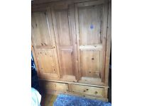 Triple door antique pine wardrobe
