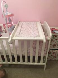 White wooden cot top changer