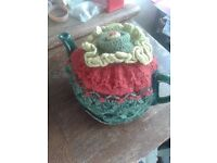 Green teapot with cosy