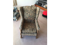 Vintage armchair. Wood and tapestry style upholstery.