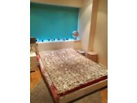 Comfy white faux leather double bed frame for sale