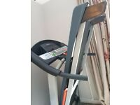 Weslo cadence 21.0 folding treadmill. 8 pre-programmed workouts, heart rate monitor and auto incline