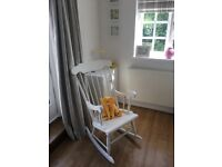 White refurbished wooden rocking chair