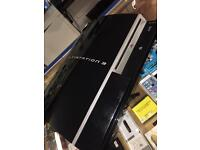PlayStation 3 with two control pads and ear piece