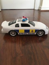 Toy police car with flashing lights and sound