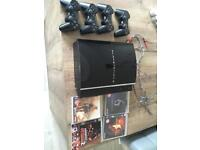 Original PS3 60gb non slim with 4 controllers and 6 games