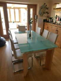 Glass extendable dining room table & chairs