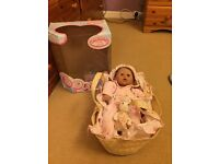 Baby annabel with Moses basket