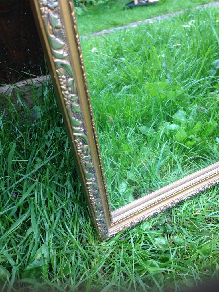 Ornate vintage brass mirror