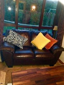 Two seater Brown leather suite. £150 as new, no marks, smoke free house, neutral style.