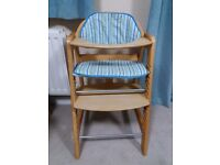 Toddler high chair for use at standard dining table.