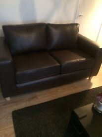 Brown leather two seater and three seater