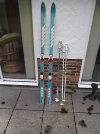 Top quality German Skis - Volkl Titanal, with Salomon Bindings and 2 pole sets