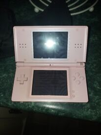 Pink nintendo ds lite for sale. Comes with case and 8 games. Excellent condition.