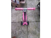 Pink micro scooter with adjustable handlebar