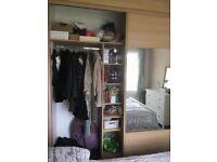 Wardrobe with mirrored sliding doors