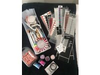Assorted Nail items including Professional Nail Trainer hand with tips