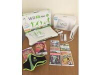 Nintendo wii console and Wii fit plus bundle