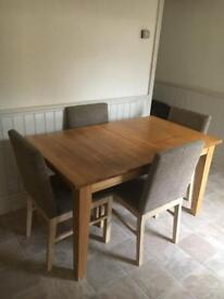 Extending dining table and four chairs